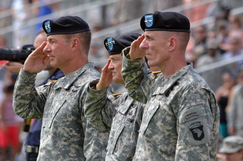 Maj. Gen. James C. McConville (left), outgoing commanding general, 101st Airborne Division (Air Assault), Gen. Daniel B. Allyn (center), commanding general, U.S. Army Forces Command, and Maj. Gen. Gary J. Volesky (right), incoming commanding general, 101st Airborne Division (Air Assault), salute during the playing of the national anthem during a change of command ceremony, June 20, 2014, at Fort Campbell, Ky. (U.S. Army photo by Larry Noller)