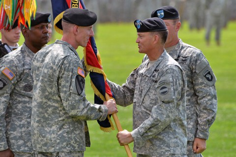 Maj. Gen. Gary J. Volesky (left), incoming commanding general, 101st Airborne Division (Air Assault), receives the division colors from Gen. Daniel B. Allyn (center), commanding general, U.S. Army Forces Command, during a change of command ceremony, June 20, 2014, at Fort Campbell, Ky. (U.S. Army photo by Larry Noller)