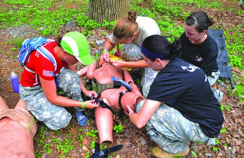 "As part of the SOAR Challenge, spouses were given a crash course in emergency field medical treatment. The training was put to use in a land navigation excerise in which included finding ""casualties.""(Major Alan Hill, 160th SOAR (A) Public Affairs)"