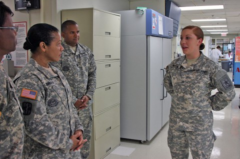 Pfc. Kassaundra Messina explains her educational experience to Army Medicine's Command Sgt. Maj. Donna Brock June 11, 2014. Messina is completing her final phase of Advanced Individual Training (AIT) in the laboratory at BACH for to become a medical laboratory technician. Around 15 AIT Soldiers train at BACH each year. Brock talked with Soldiers and noncommissioned officers-in-charge who serve throughout the hospital during her two-day visit to Fort Campbell.  (U.S. Army photo by Stacy Rzepka)