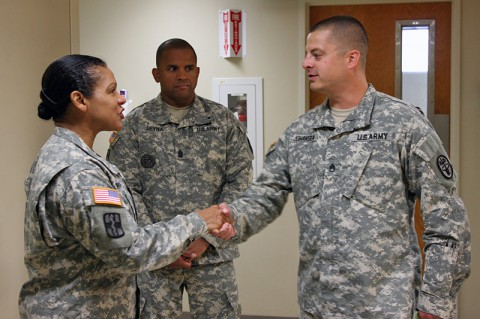 Army Medicine's Command Sgt. Maj. Donna Brock recognized Staff Sgt. Robert Johansen June 11, 2014 for his contributions in the orthopedics clinic at Blanchfield Army Community Hospital. Brock talked with Soldiers and noncommissioned officers-in-charge who serve throughout the hospital during her two-day visit to Fort Campbell. (U.S. Army photo by Stacy Rzepka)