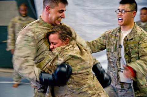 Pfc. Chelsea Kasper conducts a clench drill against Staff Sgt. Marshall Cote during level one Combatives training. Clench drills are used to train Soldiers to close the gap between them and their opponent and limit mobility. (Courtesy Photo)