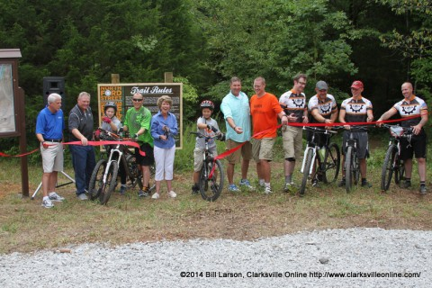 The ribbon was cut by Clarksville Mayor Kim McMillan, Clarksville Department of Parks And Recreation Director Mark Tummons, City Councilman Gino Grubbs, Drew Sanford who led the construction, along with members of the COGS Mountain Bike Club who provided volunteer manpower.