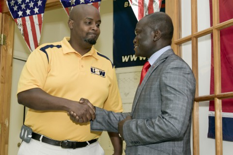Credo Amouzouvil (Right) shakes hands with Mike A. Padgett III, President of the United  Steelworkers of America, District 9 Local 501-G union after officially receiving their endorsement