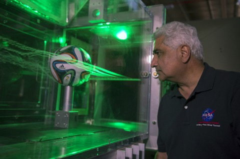 Dr. Rabi Mehta uses smoke and lasers to inspect the flow pattern around an Adidas Brazuca football. (NASA's Ames Research Center)