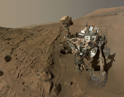 """NASA's Curiosity Mars rover used the camera at the end of its arm in April and May 2014 to take dozens of component images combined into this self-portrait where the rover drilled into a sandstone target called """"Windjana."""" (NASA/JPL-Caltech/MSSS)"""