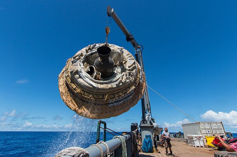 Hours after the June 28, 2014, test of NASA's Low-Density Supersonic Decelerator over the U.S. Navy's Pacific Missile Range, the saucer-shaped test vehicle is lifted aboard the Kahana recovery vessel. (NASA/JPL-Caltech)