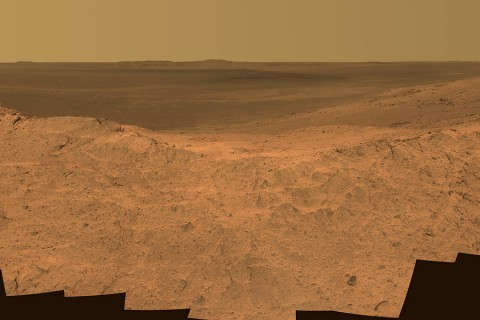 "This scene from the panoramic camera (Pancam) on NASA's Mars Exploration Rover Opportunity catches ""Pillinger Point,"" on the western rim of Endeavour Crater, in the foreground. (NASA/JPL-Caltech/Cornell Univ./Arizona State Univ.)"