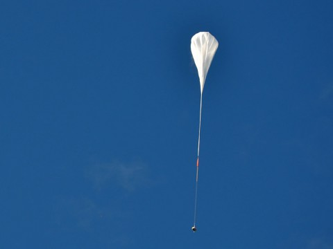 The test vehicle for NASA's Low-Density Supersonic Decelerator rides on a balloon to high altitudes above Hawaii. (NASA/JPL-Caltech)