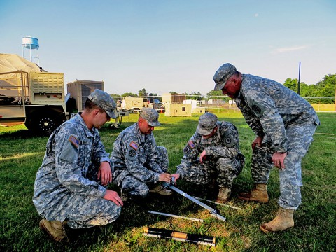 Tennessee National Guard Soldiers with the 194th Engineer Brigade in Milan, Tenn., train alongside Soldiers from the National Guard Joint Force Headquarters, Directorate of Information Management in Nashville, Tenn., to construct a High Frequency antenna to test remote communications likely to be needed in the event of a major disaster.