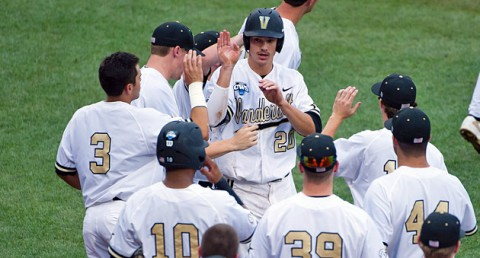 Vanderbilt Commodores outfielder Bryan Reynolds (20) celebrates with teammates after scoring against the UC Irvine Anteaters during game six of the 2014 College World Series at TD Ameritrade Park Omaha. (Steven Branscombe-USA TODAY Sports)