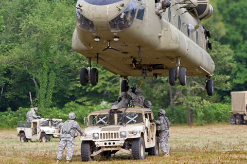 Soldiers from the 372nd Inland Cargo Transfer Company, 129th Combat Sustainment Support Battalion, 101st Sustainment Brigade, 101st Airborne Division (Air Assault), prepare to attach a Humvee to a CH-47 Chinook helicopter June 26, 2014, at Fort Campbell, Ky. The Soldiers participated in a two-day training exercise, which further developed the company's competency at providing logistical support through sling loads. (Sgt. Leejay Lockhart, 101st Sustainment Brigade Public Affairs)