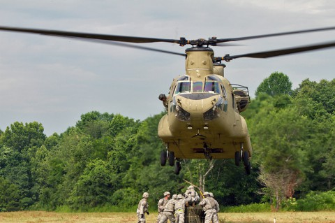 Soldiers from the 372nd Inland Cargo Transfer Company, 129th Combat Sustainment Support Battalion, 101st Sustainment Brigade, 101st Airborne Division (Air Assault), moments before securing an A-22 cargo bag to a CH-47 Chinook helicopter June 26, 2014, at Fort Campbell, Ky. The company used its air assault qualified personnel to maximum effect as they took the lead during the company's air assault training mission. (Sgt. Leejay Lockhart, 101st Sustainment Brigade Public Affairs)