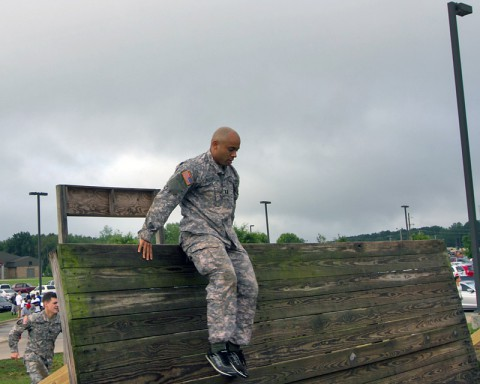 Capt. Johnathan Butler, operations officer for the 101st Special Troops Battalion, 101st Sustainment Brigade, 101st Airborne Division (Air Assault), clears the inclining wall during the 101st STB's inaugural Warrior Challenge July 2, at Fort Campbell. (U.S. Army photo by Sgt. Leejay Lockhart)