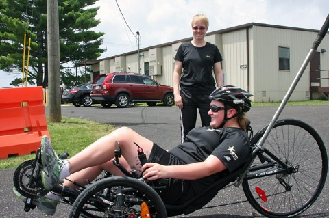 Spc. Amanda Lyle rides recumbent bicycle June 30, 2014 at Fort Campbell outside the Warrior Transition Battalion's Adaptive Reconditioning Program office. Lyle recently wheeled her way to a silver medal in recumbent cycling at the Army Warrior Games trials June 15-20 at the U.S. Military Academy, West Point, New York. (U.S. Army photo by Stacy Rzepka)