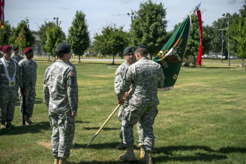 Col. John W. Brennan (right), commander of the 5th Special Forces Group (Airborne), receives the 4th Battalion colors from Lt. Col. Joseph Lock, outgoing commander of 4th Bn., 5th SFG(A), during a change of command ceremony held July 17, 2014, here at Gabriel field. (Sgt. Justin A. Moeller/U.S. Army)