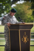 Col. John W. Brennan, commander of the 5th Special Forces Group (Airborne), gives a speech during Group Support Battalion change of command ceremony held July 25, 2014, here at Gabriel field.  (Sgt. Justin A. Moeller/U.S. Army)
