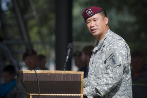 Lt. Col. Fred L. Dela Cruz, outgoing commander of the Group Support Battalion, 5th Special Forces Group (Airborne), gives a speech during GSB change of command ceremony held July 25, 2014, here at Gabriel field.  (Sgt. Justin A. Moeller/U.S. Army)
