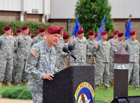 Col. John R. Evans, outgoing commander, 160th Special Operations Aviation Regiment (Airborne) addresses hundreds of distinguished visitors, Gold Star Family Members, Soldier and civilians following the change of command ceremony conducted on the Gen. Bryan Brown Compound, Fort Campbell, KY, June 27, 2014. (U.S. Army photo)
