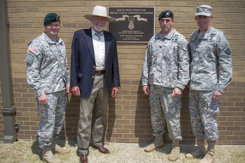 (L to R) Col. John W. Brennan, commander of the 5th Special Forces Group (Airborne), retired Maj. Drew Dix, Medal of Honor recipient and former member of the 5th SFG(A), Lt. Col. Joseph Lock, commander of 4th Battalion, 5th SFG(A) and Maj. Gen. Gary J. Volesky, commander of the 101st Airborne Division (Air Assault), stand in front of the plaque dedicating the 4th Bn. special operations complex to Dix, after a ceremony held here July 11, 2014. (Sgt. Justin A. Moeller)