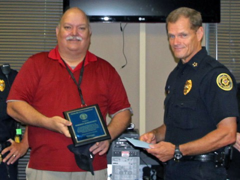 Herbert Burkhardt (left) is presented a Plaque for Outstanding Service by Clarksville Police Chief Al Ansley (right).