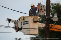 CEMC technicians replacing the blown transformer
