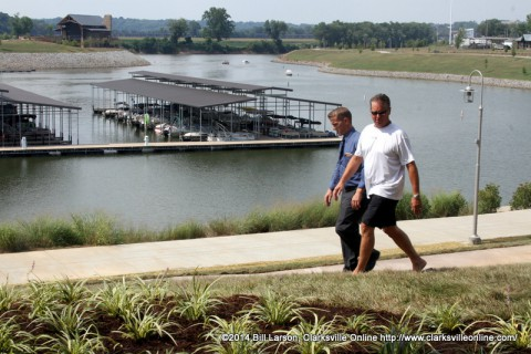 Manager Robert Bowlby (left, blue shirt) checks out the landscaping before the guests arrive for the evening