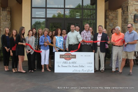 Clarksville Mayor Kim McMillan cuts the ribbon for the Liberty Park Grill
