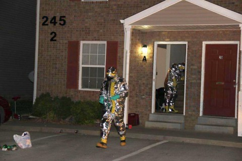 Agents retrieve items used to manufacture methamphetamine from an apartment on Executive Drive in Clarksville.