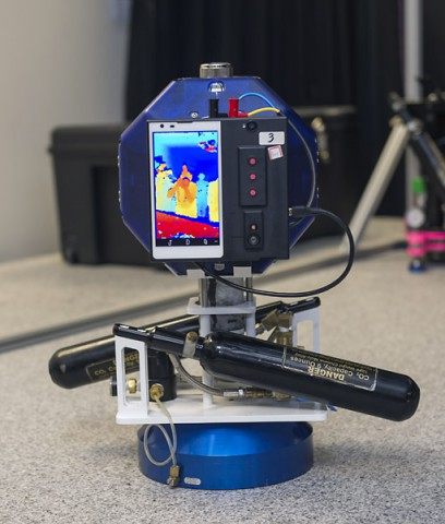 NASA Ames' Smart SPHERES, a Synchronized Position Hold, Engage, Reorient Experimental Satellites (SPHERES) equipped with Google's Project Tango smartphone. (NASA Ames / Eric James)