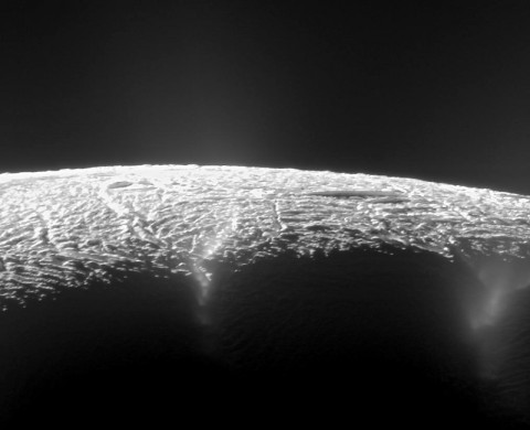 This view looks across the geyser basin of Saturn's moon Enceladus, along fractures spewing water vapor and ice particles into space. Cassini scientists have pinpointed the source locations of about 100 geysers and gained new insights into what powers them. (NASA/JPL-Caltech/SSI)