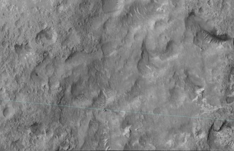 This June 27, 2014, image from the HiRISE camera on NASA's Mars Reconnaissance Orbiter shows NASA's Curiosity Mars rover on the rover's landing-ellipse boundary, which is superimposed on the image. The 12-mile-wide ellipse was mapped as safe terrain for its 2012 landing inside Gale Crater. (NASA/JPL-Caltech/Univ. of Arizona)