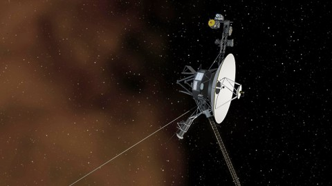 The Space Between: This artist's concept shows the Voyager 1 spacecraft entering the space between stars. Interstellar space is dominated by plasma, ionized gas (illustrated here as brownish haze), that was thrown off by giant stars millions of years ago. (NASA/JPL-Caltech)