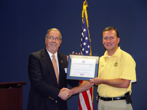 "Carl Lambert State Chair for the Tennessee Employee Support of the Guard and Reserve presents Sheriff Fuson with the ""Patriot Award"" from the Secretary of Defense"