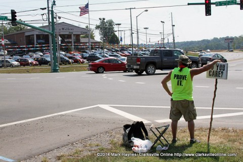 Kenny York standing at the Hwy48/13 and Riverside Drive intersection.