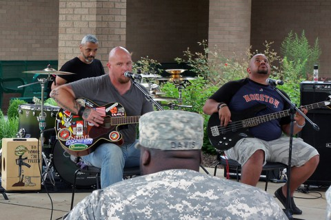 The Warrior Spirit Band, a band consisting of combat wounded veterans, performed for wounded, injured and ill Soldiers in the Warrior Transition Battalion, Fort Campbell, KY July 15, 2014 to empower Soldiers through music and give them a chance to share their stories. (Laura Boyd)