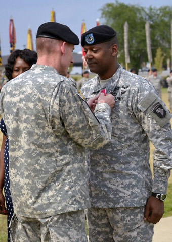 Maj. Gen. Gary J. Volesky, the commanding general of the 101st Airborne Division (Air Assault) and Fort Campbell, awards a Legion of Merit medal to Command Sgt. Maj. Alonzo J. Smith, the senior enlisted advisor of the 101st, today during a relinquishment of responsibility ceremony held in front of the division headquarters here. (Jerry Woller)