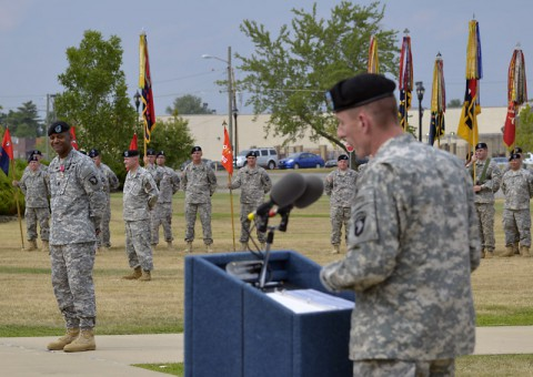 Command Sgt. Maj. Alonzo J. Smith (background, left), the senior enlisted advisor for the 101st Airborne Division (Air Assault), smiles as he listens to the remarks from Maj. Gen. Gary J. Volesky, the commanding general of the 101st and Fort Campbell, during Smith's relinquishment of responsibility ceremony today. (Jerry Woller)