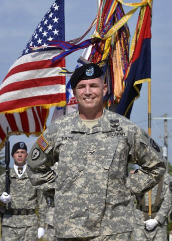 Colonel Frank W. Tate, the new deputy commanding general for support for the 101st Airborne Division (Air Assault) and Fort Campbell, smiles as he listens to Maj. Gen. Gary J. Volesky (not pictured), the commanding general of the 101st, officially welcome him to the division during his remarks at an Honor Eagle ceremony Aug. 8, 2014, in front of the division headquarters building. (U.S. Army Photo by Sam Shore)