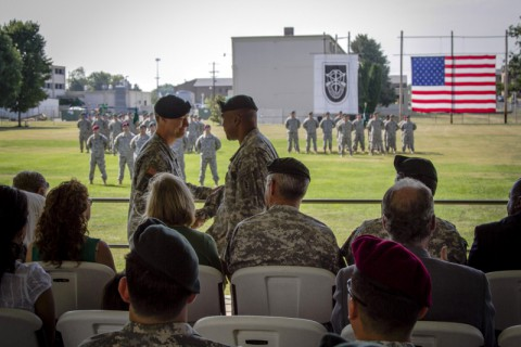 Lt. Col. John R. Dyke III, the outgoing commander of 2nd Battalion, 5th Special Forces Group (Airborne),shakes the hand of Lt. Col. Solomon Wood, the incoming commander of 2nd Bn., 5th SFG (A), July 31, 2014, during the 2nd Bn. Change of Command ceremony. (Sgt. Justin A. Moeller/U.S. Army)