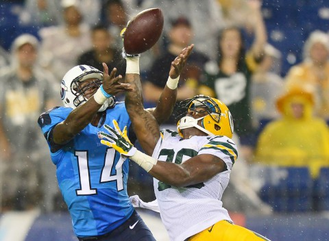 Green Bay Packers cornerback Demitri Goodson (39) breaks up a pass intended for Tennessee Titans wide receiver Micheal Preston (14) during the second half at LP Field. The Titans beat the Packers 20-16. (Don McPeak-USA TODAY Sports)