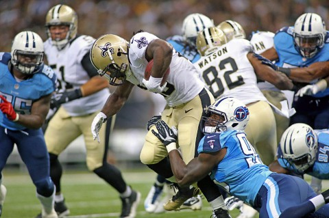 New Orleans Saints running back Khiry Robinson (29) is tackled by Tennessee Titans defensive end Kamerion Wimbley (95) as he carries the ball in the first half at Mercedes-Benz Superdome last week. (Crystal LoGiudice-USA TODAY Sports)