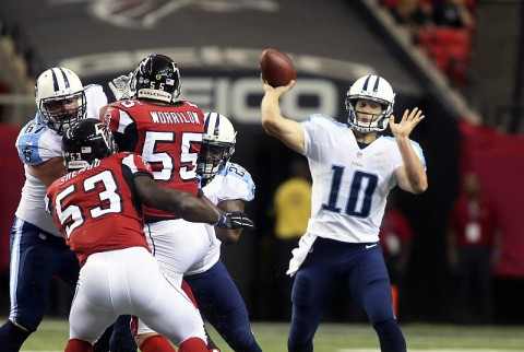 Tennessee Titans quarterback Jake Locker (10) attempts a pass against the Atlanta Falcons are shown on the play in the first quarter of their game at the Georgia Dome. (Jason Getz-USA TODAY Sports)