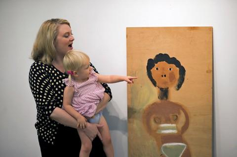 "Karen Parr-Moody and her daughter, Stella, donate Jimmy Lee Sudduth's ""Bikini Girl"" to Austin Peay State University. (Taylor Slifko/APSU)"