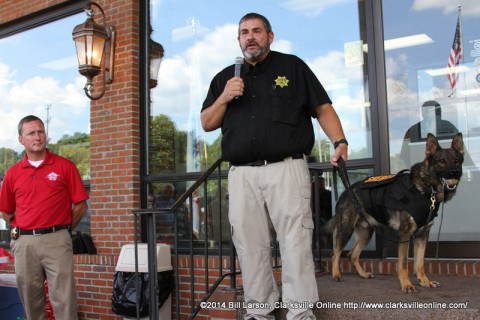 Montgomery County Sheriff John Fuson looks on as MCSO SGT. Mike Oliver with his K-9 partner Links speak to the crowd