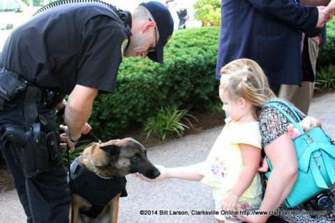 A young lady meets Deputy Eric Trout and his K-9 partner Fuse