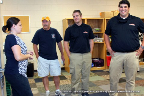 Rebecca Dyer, CMCSS Foundation and Community Relations Assistant talks with David Kirkland, President -Clarksville Firefighters Asso. Local 3180, Gary Orr, Construction Manager for Servpro of Montgomery County, and Gavin Parchman, Business Development Manager Servpro of Montgomery County