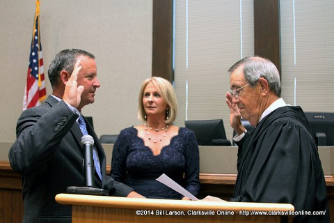 Montgomery County Mayor Jim Durrett being sworn in by Judge John Peay (Ret.) as his wife Mary looks on