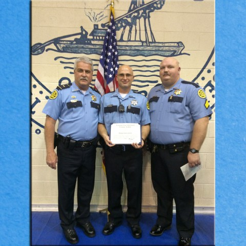Lt. Cliff Smith poses with Deputy Bryan Green and Sgt. Robert Boone after Green graduated from Tennessee Law Enforcement Training Academy today