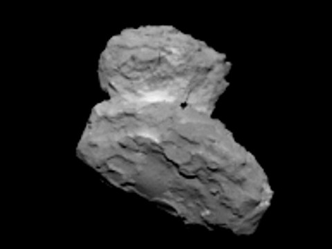 OSIRIS narrow angle camera view of 67P/C-G from a distance of 1000 km on 1st August 2014. Note that the dark spot is an artefact from the onboard CCD. (ESA/Rosetta/MPS for OSIRIS Team MPS/UPD/LAM/IAA/SSO/INTA/UPM/DASP/IDA)